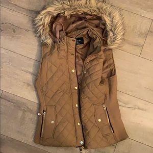 Tan, fur lined hooded, vest.